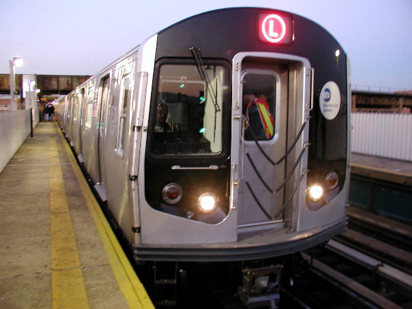 (65k, 600x450)<br><b>Country:</b> United States<br><b>City:</b> New York<br><b>System:</b> New York City Transit<br><b>Line:</b> BMT Canarsie Line<br><b>Location:</b> Livonia Avenue <br><b>Route:</b> L<br><b>Car:</b> R-143 (Kawasaki, 2001-2002) 8108 <br><b>Photo by:</b> Trevor Logan<br><b>Date:</b> 12/4/2001<br><b>Viewed (this week/total):</b> 1 / 4256