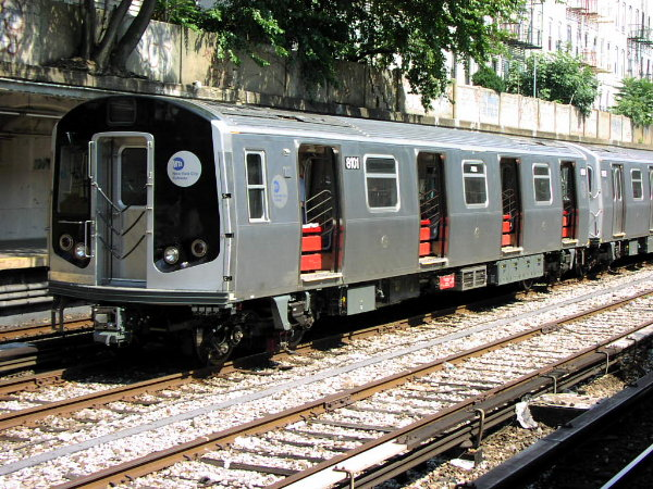 (120k, 600x450)<br><b>Country:</b> United States<br><b>City:</b> New York<br><b>System:</b> New York City Transit<br><b>Line:</b> BMT Sea Beach Line<br><b>Location:</b> 18th Avenue <br><b>Car:</b> R-143 (Kawasaki, 2001-2002) 8101 <br><b>Photo by:</b> Trevor Logan<br><b>Date:</b> 8/22/2001<br><b>Viewed (this week/total):</b> 0 / 7315