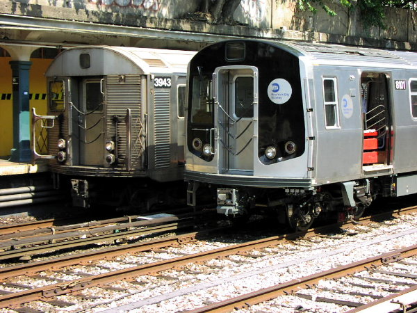 (109k, 600x450)<br><b>Country:</b> United States<br><b>City:</b> New York<br><b>System:</b> New York City Transit<br><b>Line:</b> BMT Sea Beach Line<br><b>Location:</b> 18th Avenue <br><b>Car:</b> R-143 (Kawasaki, 2001-2002) 8101 <br><b>Photo by:</b> Trevor Logan<br><b>Date:</b> 8/22/2001<br><b>Notes:</b> With R32 3943<br><b>Viewed (this week/total):</b> 8 / 6633