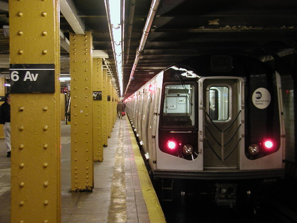 (68k, 600x450)<br><b>Country:</b> United States<br><b>City:</b> New York<br><b>System:</b> New York City Transit<br><b>Line:</b> BMT Canarsie Line<br><b>Location:</b> 6th Avenue <br><b>Route:</b> L<br><b>Car:</b> R-143 (Kawasaki, 2001-2002) 8108 <br><b>Photo by:</b> Trevor Logan<br><b>Date:</b> 12/6/2001<br><b>Viewed (this week/total):</b> 4 / 5504