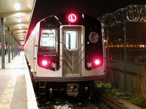 (81k, 600x450)<br><b>Country:</b> United States<br><b>City:</b> New York<br><b>System:</b> New York City Transit<br><b>Line:</b> BMT Canarsie Line<br><b>Location:</b> Rockaway Parkway <br><b>Route:</b> L<br><b>Car:</b> R-143 (Kawasaki, 2001-2002) 8108 <br><b>Photo by:</b> Trevor Logan<br><b>Date:</b> 12/6/2001<br><b>Viewed (this week/total):</b> 1 / 4900