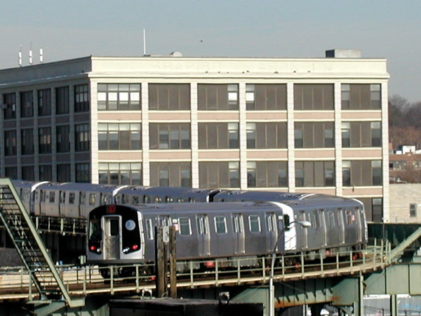 (75k, 600x450)<br><b>Country:</b> United States<br><b>City:</b> New York<br><b>System:</b> New York City Transit<br><b>Line:</b> BMT Canarsie Line<br><b>Location:</b> Snediker Avenue <br><b>Route:</b> L<br><b>Car:</b> R-143 (Kawasaki, 2001-2002) 8108 <br><b>Photo by:</b> Trevor Logan<br><b>Date:</b> 12/6/2001<br><b>Viewed (this week/total):</b> 1 / 6649