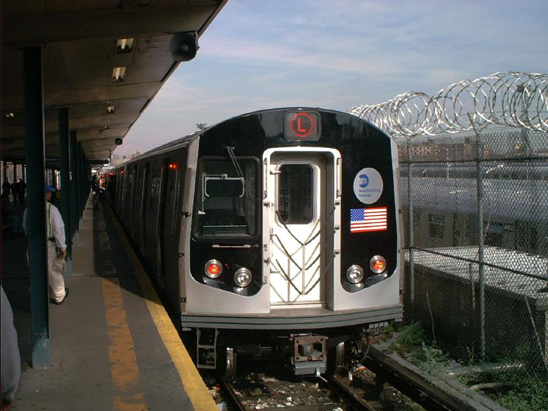 (78k, 800x600)<br><b>Country:</b> United States<br><b>City:</b> New York<br><b>System:</b> New York City Transit<br><b>Line:</b> BMT Canarsie Line<br><b>Location:</b> Rockaway Parkway <br><b>Route:</b> L<br><b>Car:</b> R-143 (Kawasaki, 2001-2002) 8108 <br><b>Photo by:</b> Tony Mirabella<br><b>Date:</b> 12/7/2001<br><b>Viewed (this week/total):</b> 3 / 3995