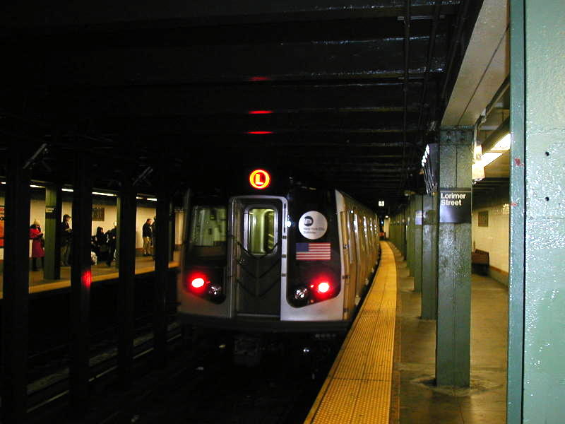 (62k, 800x600)<br><b>Country:</b> United States<br><b>City:</b> New York<br><b>System:</b> New York City Transit<br><b>Line:</b> BMT Canarsie Line<br><b>Location:</b> Lorimer Street <br><b>Route:</b> L<br><b>Car:</b> R-143 (Kawasaki, 2001-2002) 8108 <br><b>Photo by:</b> Todd Glickman<br><b>Date:</b> 12/20/2001<br><b>Viewed (this week/total):</b> 1 / 6604