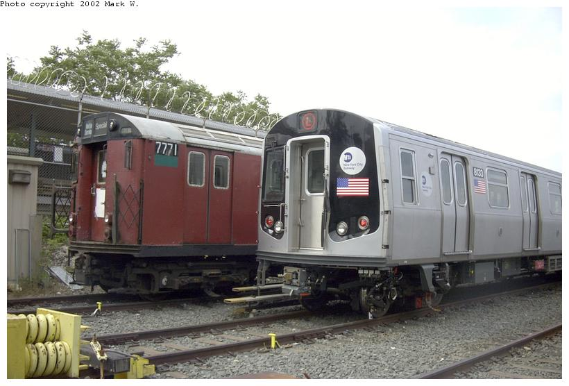 (70k, 820x556)<br><b>Country:</b> United States<br><b>City:</b> New York<br><b>System:</b> New York City Transit<br><b>Location:</b> Rockaway Parkway (Canarsie) Yard<br><b>Car:</b> R-143 (Kawasaki, 2001-2002) 8133 <br><b>Photo by:</b> Mark W.<br><b>Date:</b> 6/2002<br><b>Notes:</b> With R26 7771 School Car<br><b>Viewed (this week/total):</b> 0 / 4928
