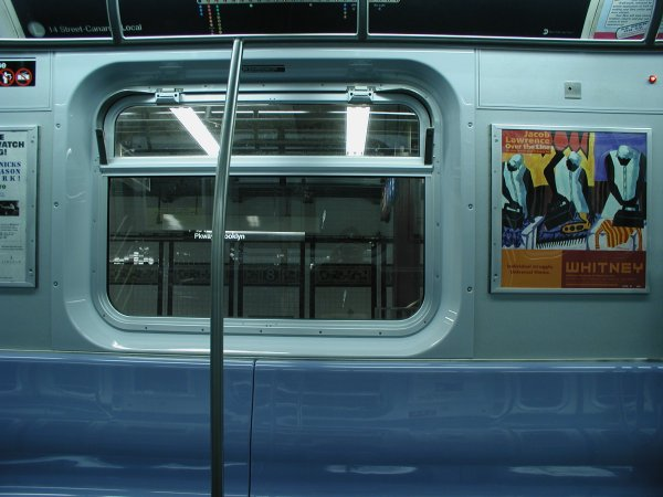 (50k, 600x450)<br><b>Country:</b> United States<br><b>City:</b> New York<br><b>System:</b> New York City Transit<br><b>Car:</b> R-143 (Kawasaki, 2001-2002) Interior <br><b>Photo by:</b> Clayton Parker<br><b>Date:</b> 12/15/2001<br><b>Viewed (this week/total):</b> 1 / 3457