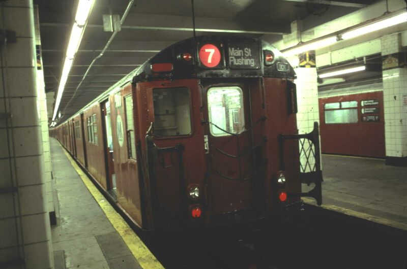 (54k, 800x530)<br><b>Country:</b> United States<br><b>City:</b> New York<br><b>System:</b> New York City Transit<br><b>Line:</b> IRT Flushing Line<br><b>Location:</b> Main Street/Flushing <br><b>Route:</b> 7<br><b>Car:</b> R-33 Main Line (St. Louis, 1962-63) 9111 <br><b>Photo by:</b> Glenn L. Rowe<br><b>Date:</b> 6/19/1991<br><b>Viewed (this week/total):</b> 0 / 8830