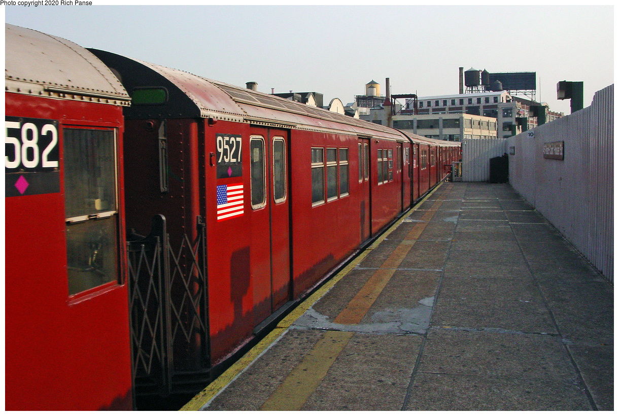 (51k, 820x620)<br><b>Country:</b> United States<br><b>City:</b> New York<br><b>System:</b> New York City Transit<br><b>Line:</b> IRT Flushing Line<br><b>Location:</b> Court House Square/45th Road <br><b>Route:</b> 7<br><b>Car:</b> R-36 Main Line (St. Louis, 1964) 9527 <br><b>Photo by:</b> Richard Panse<br><b>Date:</b> 7/18/2002<br><b>Viewed (this week/total):</b> 0 / 2065