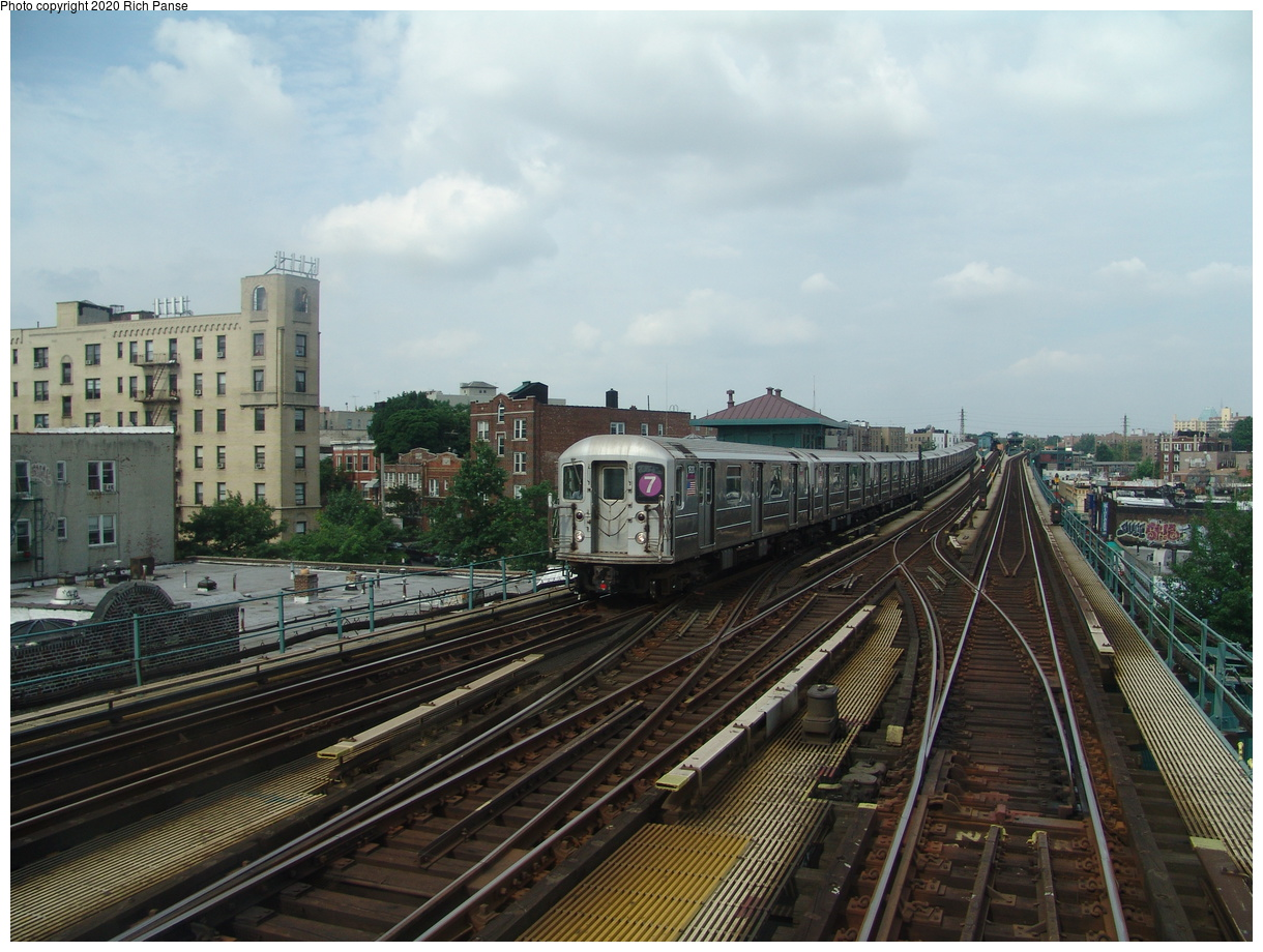 (93k, 820x620)<br><b>Country:</b> United States<br><b>City:</b> New York<br><b>System:</b> New York City Transit<br><b>Line:</b> IRT Flushing Line<br><b>Location:</b> 69th Street/Fisk Avenue <br><b>Route:</b> 7<br><b>Car:</b> R-62A (Bombardier, 1984-1987)  1820 <br><b>Photo by:</b> Richard Panse<br><b>Date:</b> 6/19/2004<br><b>Viewed (this week/total):</b> 5 / 2649