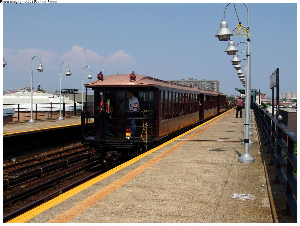(165k, 1044x788)<br><b>Country:</b> United States<br><b>City:</b> New York<br><b>System:</b> New York City Transit<br><b>Line:</b> IND Rockaway<br><b>Location:</b> Beach 105th Street/Seaside <br><b>Route:</b> Fan Trip<br><b>Car:</b> BMT Elevated Gate Car 1407, 1273, 1404 <br><b>Photo by:</b> Richard Panse<br><b>Date:</b> 7/17/2004<br><b>Viewed (this week/total):</b> 0 / 1960