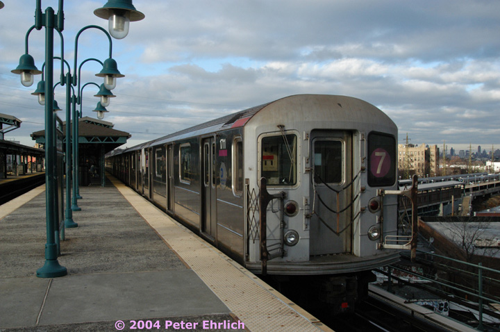 (137k, 720x478)<br><b>Country:</b> United States<br><b>City:</b> New York<br><b>System:</b> New York City Transit<br><b>Line:</b> IRT Flushing Line<br><b>Location:</b> 61st Street/Woodside <br><b>Route:</b> 7<br><b>Car:</b> R-62A (Bombardier, 1984-1987)  1711 <br><b>Photo by:</b> Peter Ehrlich<br><b>Date:</b> 12/25/2003<br><b>Viewed (this week/total):</b> 0 / 2034