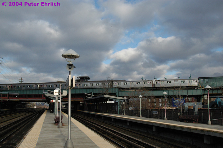 (119k, 720x478)<br><b>Country:</b> United States<br><b>City:</b> New York<br><b>System:</b> New York City Transit<br><b>Line:</b> IRT Flushing Line<br><b>Location:</b> 61st Street/Woodside <br><b>Route:</b> 7<br><b>Car:</b> R-62A (Bombardier, 1984-1987)  1795 <br><b>Photo by:</b> Peter Ehrlich<br><b>Date:</b> 12/25/2003<br><b>Notes:</b> View from the Long Island Rail Road platform.<br><b>Viewed (this week/total):</b> 5 / 2975