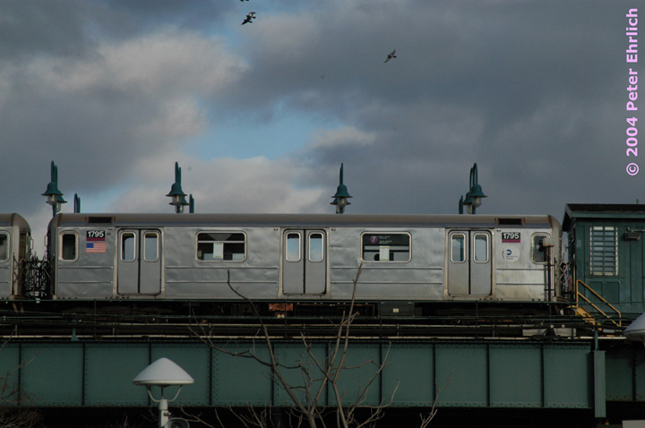 (102k, 720x478)<br><b>Country:</b> United States<br><b>City:</b> New York<br><b>System:</b> New York City Transit<br><b>Line:</b> IRT Flushing Line<br><b>Location:</b> 61st Street/Woodside <br><b>Route:</b> 7<br><b>Car:</b> R-62A (Bombardier, 1984-1987)  1795 <br><b>Photo by:</b> Peter Ehrlich<br><b>Date:</b> 12/25/2003<br><b>Notes:</b> View from the Long Island Rail Road platform.<br><b>Viewed (this week/total):</b> 0 / 2641