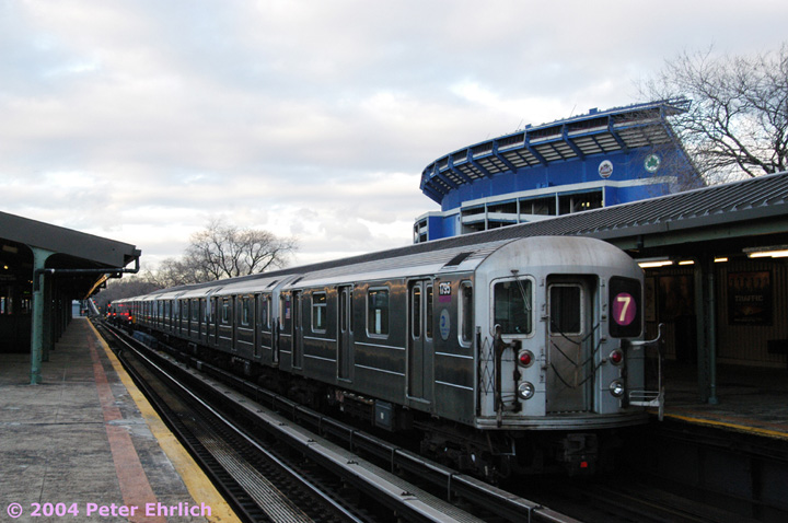 (133k, 720x478)<br><b>Country:</b> United States<br><b>City:</b> New York<br><b>System:</b> New York City Transit<br><b>Line:</b> IRT Flushing Line<br><b>Location:</b> Willets Point/Mets (fmr. Shea Stadium) <br><b>Route:</b> 7<br><b>Car:</b> R-62A (Bombardier, 1984-1987)  1795 <br><b>Photo by:</b> Peter Ehrlich<br><b>Date:</b> 12/25/2003<br><b>Viewed (this week/total):</b> 1 / 2637