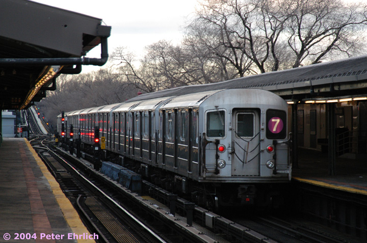 (162k, 720x478)<br><b>Country:</b> United States<br><b>City:</b> New York<br><b>System:</b> New York City Transit<br><b>Line:</b> IRT Flushing Line<br><b>Location:</b> Willets Point/Mets (fmr. Shea Stadium) <br><b>Route:</b> 7<br><b>Car:</b> R-62A (Bombardier, 1984-1987)  1795 <br><b>Photo by:</b> Peter Ehrlich<br><b>Date:</b> 12/25/2003<br><b>Viewed (this week/total):</b> 2 / 2703