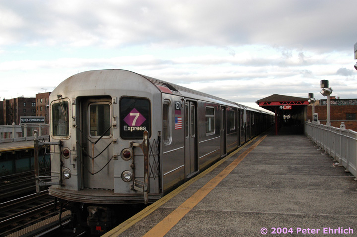 (123k, 720x478)<br><b>Country:</b> United States<br><b>City:</b> New York<br><b>System:</b> New York City Transit<br><b>Line:</b> IRT Flushing Line<br><b>Location:</b> 90th Street/Elmhurst Avenue <br><b>Route:</b> 7<br><b>Car:</b> R-62A (Bombardier, 1984-1987)  1801 <br><b>Photo by:</b> Peter Ehrlich<br><b>Date:</b> 12/25/2003<br><b>Viewed (this week/total):</b> 4 / 5157