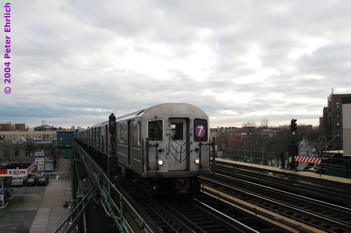 (115k, 720x478)<br><b>Country:</b> United States<br><b>City:</b> New York<br><b>System:</b> New York City Transit<br><b>Line:</b> IRT Flushing Line<br><b>Location:</b> 90th Street/Elmhurst Avenue <br><b>Route:</b> 7<br><b>Car:</b> R-62A (Bombardier, 1984-1987)  2030 <br><b>Photo by:</b> Peter Ehrlich<br><b>Date:</b> 12/25/2003<br><b>Viewed (this week/total):</b> 4 / 2091