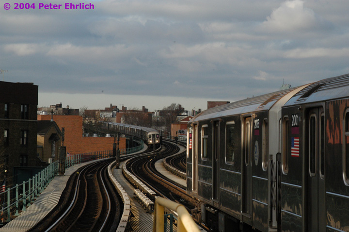 (123k, 720x478)<br><b>Country:</b> United States<br><b>City:</b> New York<br><b>System:</b> New York City Transit<br><b>Line:</b> IRT Flushing Line<br><b>Location:</b> 61st Street/Woodside <br><b>Route:</b> 7<br><b>Car:</b> R-62A (Bombardier, 1984-1987)  2035 <br><b>Photo by:</b> Peter Ehrlich<br><b>Date:</b> 12/25/2003<br><b>Notes:</b> Rare Christmas Day operation on the express track, made necessary due to a problem further inbound between 61st Street and Queensboro Plaza.<br><b>Viewed (this week/total):</b> 5 / 3383