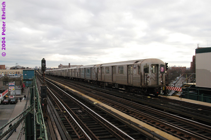 (134k, 720x478)<br><b>Country:</b> United States<br><b>City:</b> New York<br><b>System:</b> New York City Transit<br><b>Line:</b> IRT Flushing Line<br><b>Location:</b> 90th Street/Elmhurst Avenue <br><b>Route:</b> 7<br><b>Car:</b> R-62A (Bombardier, 1984-1987)  2113 <br><b>Photo by:</b> Peter Ehrlich<br><b>Date:</b> 12/25/2003<br><b>Viewed (this week/total):</b> 0 / 2039