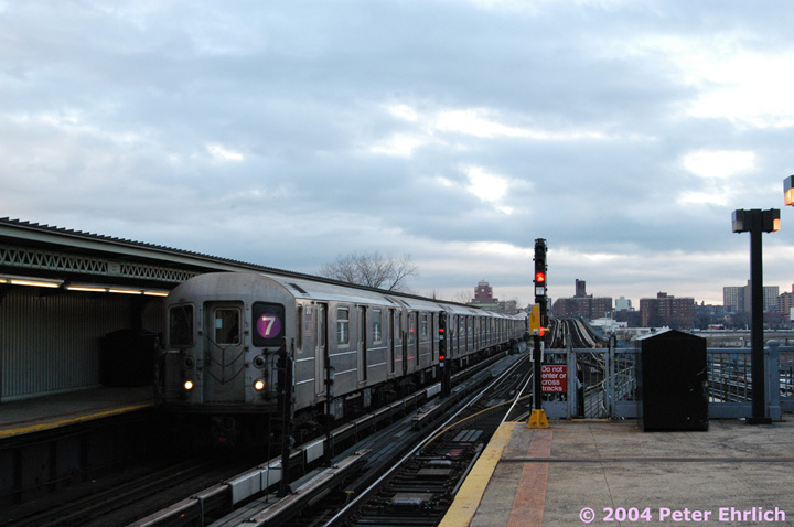 (112k, 720x478)<br><b>Country:</b> United States<br><b>City:</b> New York<br><b>System:</b> New York City Transit<br><b>Line:</b> IRT Flushing Line<br><b>Location:</b> Willets Point/Mets (fmr. Shea Stadium) <br><b>Route:</b> 7<br><b>Car:</b> R-62A (Bombardier, 1984-1987)  2117 <br><b>Photo by:</b> Peter Ehrlich<br><b>Date:</b> 12/25/2003<br><b>Viewed (this week/total):</b> 1 / 2535