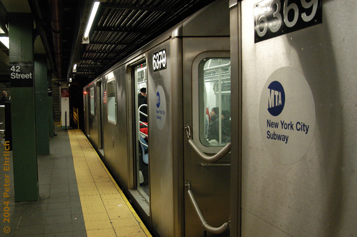 (140k, 720x478)<br><b>Country:</b> United States<br><b>City:</b> New York<br><b>System:</b> New York City Transit<br><b>Line:</b> IRT West Side Line<br><b>Location:</b> Times Square/42nd Street <br><b>Route:</b> 2<br><b>Car:</b> R-142 (Primary Order, Bombardier, 1999-2002)  6370 <br><b>Photo by:</b> Peter Ehrlich<br><b>Date:</b> 12/25/2003<br><b>Viewed (this week/total):</b> 0 / 4715