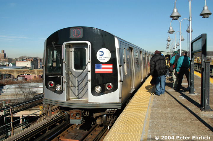 (167k, 720x478)<br><b>Country:</b> United States<br><b>City:</b> New York<br><b>System:</b> New York City Transit<br><b>Line:</b> BMT Canarsie Line<br><b>Location:</b> Atlantic Avenue <br><b>Route:</b> L<br><b>Car:</b> R-143 (Kawasaki, 2001-2002) 8256 <br><b>Photo by:</b> Peter Ehrlich<br><b>Date:</b> 12/28/2003<br><b>Viewed (this week/total):</b> 0 / 3854