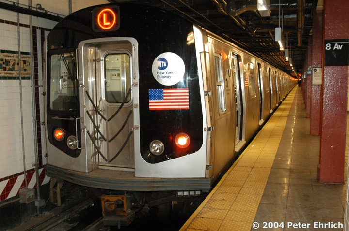 (172k, 720x478)<br><b>Country:</b> United States<br><b>City:</b> New York<br><b>System:</b> New York City Transit<br><b>Line:</b> BMT Canarsie Line<br><b>Location:</b> 8th Avenue <br><b>Route:</b> L<br><b>Car:</b> R-143 (Kawasaki, 2001-2002) 8296 <br><b>Photo by:</b> Peter Ehrlich<br><b>Date:</b> 12/28/2003<br><b>Viewed (this week/total):</b> 0 / 3356