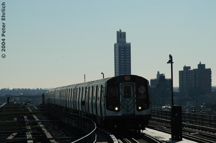 (87k, 720x478)<br><b>Country:</b> United States<br><b>City:</b> New York<br><b>System:</b> New York City Transit<br><b>Line:</b> BMT Canarsie Line<br><b>Location:</b> Atlantic Avenue <br><b>Route:</b> L<br><b>Car:</b> R-143 (Kawasaki, 2001-2002)  <br><b>Photo by:</b> Peter Ehrlich<br><b>Date:</b> 12/28/2003<br><b>Viewed (this week/total):</b> 0 / 3444