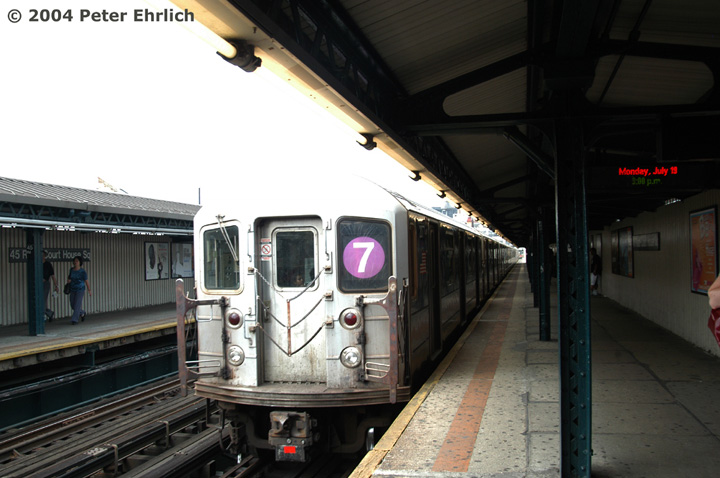 (119k, 720x478)<br><b>Country:</b> United States<br><b>City:</b> New York<br><b>System:</b> New York City Transit<br><b>Line:</b> IRT Flushing Line<br><b>Location:</b> Court House Square/45th Road <br><b>Route:</b> 7<br><b>Car:</b> R-62A (Bombardier, 1984-1987)  2077 <br><b>Photo by:</b> Peter Ehrlich<br><b>Date:</b> 7/19/2004<br><b>Viewed (this week/total):</b> 2 / 2317