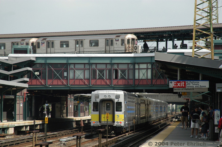 (156k, 720x478)<br><b>Country:</b> United States<br><b>City:</b> New York<br><b>System:</b> New York City Transit<br><b>Line:</b> IRT Flushing Line<br><b>Location:</b> 61st Street/Woodside <br><b>Route:</b> 7<br><b>Car:</b> R-62A (Bombardier, 1984-1987)  2111 <br><b>Photo by:</b> Peter Ehrlich<br><b>Date:</b> 7/19/2004<br><b>Notes:</b> View from the LIRR platform, with push-pull LIRR diesel train cab car 5017.<br><b>Viewed (this week/total):</b> 0 / 8976