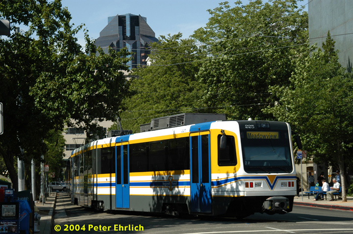 (217k, 720x478)<br><b>Country:</b> United States<br><b>City:</b> Sacramento, CA<br><b>System:</b> SACRT Light Rail<br><b>Location:</b> 8th & O <br><b>Car:</b> Sacramento CAF LRV  225 <br><b>Photo by:</b> Peter Ehrlich<br><b>Date:</b> 6/28/2004<br><b>Notes:</b> Train has just turned north onto 8th Street and will stop at Capitol before turning back on K Street.<br><b>Viewed (this week/total):</b> 2 / 1008