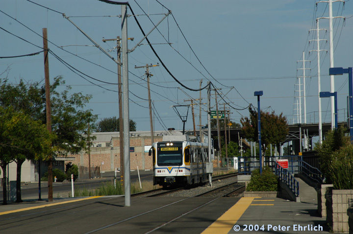 (150k, 720x478)<br><b>Country:</b> United States<br><b>City:</b> Sacramento, CA<br><b>System:</b> SACRT Light Rail<br><b>Location:</b> University/65th <br><b>Car:</b> Sacramento CAF LRV  233 <br><b>Photo by:</b> Peter Ehrlich<br><b>Date:</b> 6/27/2004<br><b>Notes:</b> Arriving University/65th Street Station from the East (inbound).  The US 50 Freeway is in the background, and a viaduct for the LRT will cross over the UP Folsom Branch and duck under the freeway.<br><b>Viewed (this week/total):</b> 1 / 1153