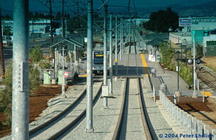 (200k, 720x468)<br><b>Country:</b> United States<br><b>City:</b> Sacramento, CA<br><b>System:</b> SACRT Light Rail<br><b>Location:</b> Sunrise <br><b>Photo by:</b> Peter Ehrlich<br><b>Date:</b> 6/27/2004<br><b>Notes:</b> On the viaduct crossing Sunrise Blvd.  A railroad spur goes off the paralleling UP Folsom Branch here, necessitating the grade separation.  The last image was taken from an arriving train, as evidenced by the tint on the upper windshield.<br><b>Viewed (this week/total):</b> 0 / 1428