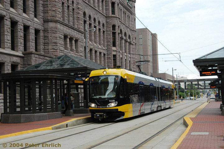 (155k, 720x478)<br><b>Country:</b> United States<br><b>City:</b> Minneapolis, MN<br><b>System:</b> MNDOT Light Rail Transit<br><b>Line:</b> Hiawatha Line<br><b>Location:</b> <b><u>Government Plaza </b></u><br><b>Car:</b> Bombardier Flexity Swift  102 <br><b>Photo by:</b> Peter Ehrlich<br><b>Date:</b> 8/2/2004<br><b>Viewed (this week/total):</b> 0 / 1431