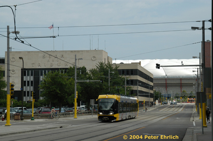 (121k, 720x478)<br><b>Country:</b> United States<br><b>City:</b> Minneapolis, MN<br><b>System:</b> MNDOT Light Rail Transit<br><b>Line:</b> Hiawatha Line<br><b>Location:</b> S. 5th Street/5th Avenue <br><b>Car:</b> Bombardier Flexity Swift  107 <br><b>Photo by:</b> Peter Ehrlich<br><b>Date:</b> 8/2/2004<br><b>Viewed (this week/total):</b> 0 / 1326