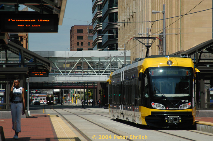 (165k, 720x478)<br><b>Country:</b> United States<br><b>City:</b> Minneapolis, MN<br><b>System:</b> MNDOT Light Rail Transit<br><b>Line:</b> Hiawatha Line<br><b>Location:</b> <b><u>Government Plaza </b></u><br><b>Car:</b> Bombardier Flexity Swift  111 <br><b>Photo by:</b> Peter Ehrlich<br><b>Date:</b> 8/2/2004<br><b>Notes:</b> View north along S. 5th Street from Government Plaza Station..<br><b>Viewed (this week/total):</b> 0 / 1495