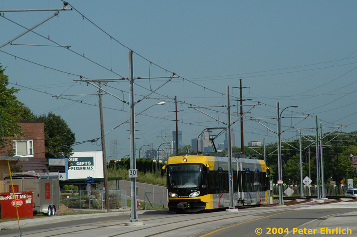 (133k, 720x479)<br><b>Country:</b> United States<br><b>City:</b> Minneapolis, MN<br><b>System:</b> MNDOT Light Rail Transit<br><b>Line:</b> Hiawatha Line<br><b>Location:</b> Minnehaha Avenue/52nd Street <br><b>Car:</b> Bombardier Flexity Swift  111 <br><b>Photo by:</b> Peter Ehrlich<br><b>Date:</b> 8/2/2004<br><b>Notes:</b> At 52nd Street, the line turns off of Hiawatha Blvd. and onto Minnehaha Avenue for a few blocks of street running.<br><b>Viewed (this week/total):</b> 4 / 1353