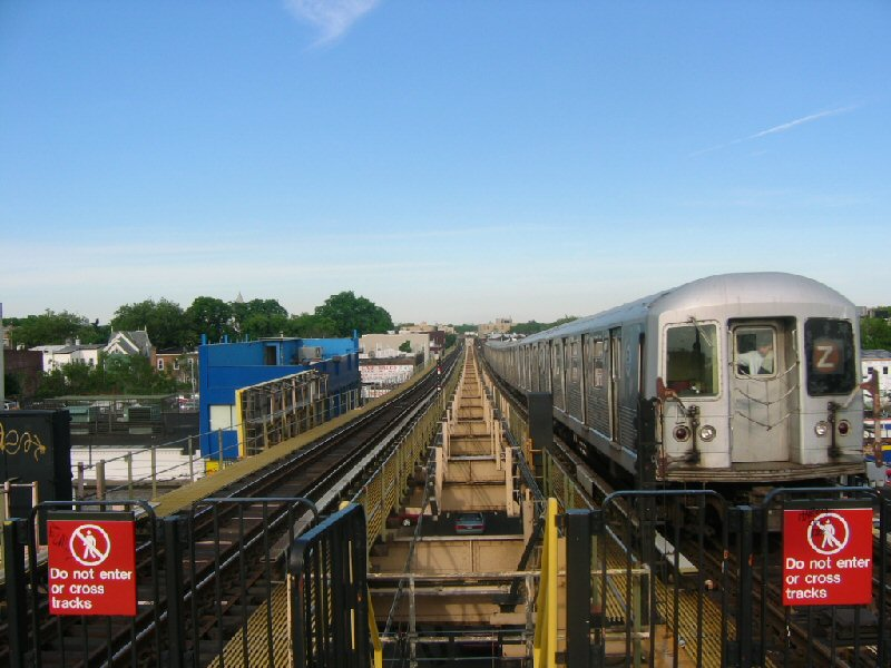 (99k, 800x600)<br><b>Country:</b> United States<br><b>City:</b> New York<br><b>System:</b> New York City Transit<br><b>Line:</b> BMT Nassau Street/Jamaica Line<br><b>Location:</b> Alabama Avenue <br><b>Route:</b> Z<br><b>Car:</b> R-42 (St. Louis, 1969-1970)   <br><b>Photo by:</b> Dante D. Angerville<br><b>Date:</b> 5/20/2004<br><b>Viewed (this week/total):</b> 3 / 3727
