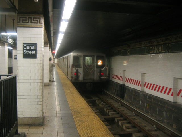 (156k, 640x480)<br><b>Country:</b> United States<br><b>City:</b> New York<br><b>System:</b> New York City Transit<br><b>Line:</b> BMT Nassau Street/Jamaica Line<br><b>Location:</b> Canal Street <br><b>Route:</b> Z<br><b>Car:</b> R-42 (St. Louis, 1969-1970)   <br><b>Photo by:</b> Dante D. Angerville<br><b>Date:</b> 9/23/2004<br><b>Viewed (this week/total):</b> 4 / 5956