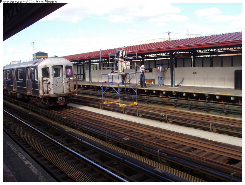 (106k, 820x620)<br><b>Country:</b> United States<br><b>City:</b> New York<br><b>System:</b> New York City Transit<br><b>Line:</b> IRT Flushing Line<br><b>Location:</b> 74th Street/Broadway <br><b>Car:</b> R-62A (Bombardier, 1984-1987)  2082 <br><b>Photo by:</b> Marc Pitanza<br><b>Date:</b> 10/11/2004<br><b>Notes:</b> Note platform repair work utilizing a special scaffold meant to ride the rails.<br><b>Viewed (this week/total):</b> 2 / 3199
