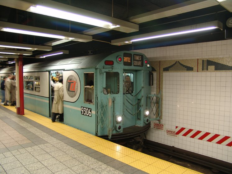 (90k, 746x560)<br><b>Country:</b> United States<br><b>City:</b> New York<br><b>System:</b> New York City Transit<br><b>Line:</b> IRT Times Square-Grand Central Shuttle<br><b>Location:</b> Grand Central <br><b>Route:</b> Fan Trip<br><b>Car:</b> R-33 World's Fair (St. Louis, 1963-64) 9306 <br><b>Photo by:</b> Richard Panse<br><b>Date:</b> 10/27/2004<br><b>Notes:</b> Train in regular passenger service, technically not a fan trip.<br><b>Viewed (this week/total):</b> 0 / 2775