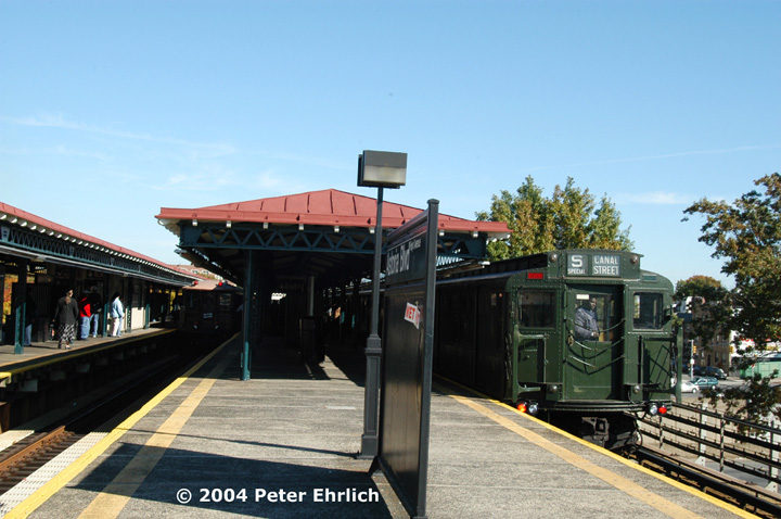 (141k, 720x478)<br><b>Country:</b> United States<br><b>City:</b> New York<br><b>System:</b> New York City Transit<br><b>Line:</b> BMT Astoria Line<br><b>Location:</b> Astoria Boulevard/Hoyt Avenue <br><b>Route:</b> Fan Trip<br><b>Car:</b> BMT Elevated Gate Car 1407 <br><b>Photo by:</b> Peter Ehrlich<br><b>Date:</b> 10/28/2004<br><b>Notes:</b> BU train in excursion service on Astoria line.<br><b>Viewed (this week/total):</b> 2 / 2340