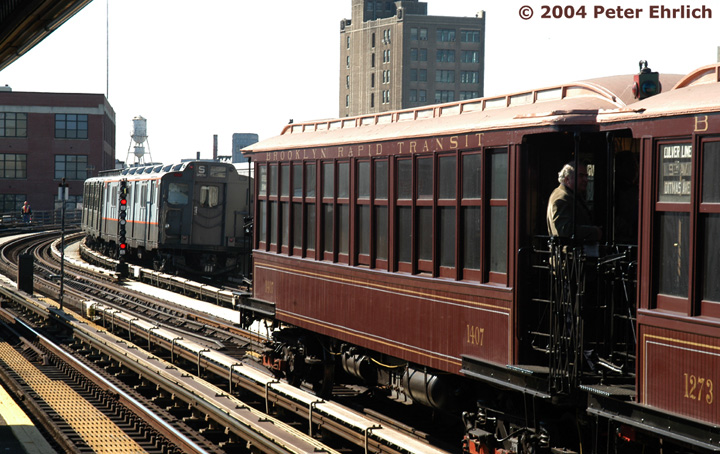 (168k, 720x454)<br><b>Country:</b> United States<br><b>City:</b> New York<br><b>System:</b> New York City Transit<br><b>Line:</b> BMT Astoria Line<br><b>Location:</b> 39th/Beebe Aves. <br><b>Route:</b> Fan Trip<br><b>Car:</b> BMT Elevated Gate Car 1407 <br><b>Photo by:</b> Peter Ehrlich<br><b>Date:</b> 10/28/2004<br><b>Notes:</b> BU train in excursion service on Astoria line.<br><b>Viewed (this week/total):</b> 2 / 2905