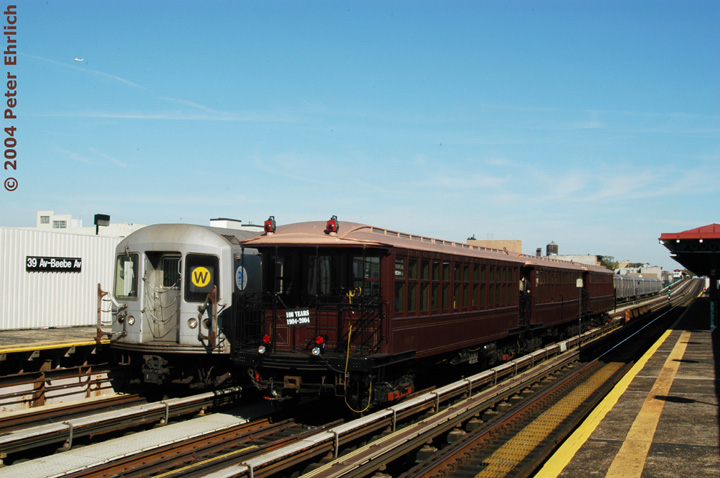 (133k, 720x478)<br><b>Country:</b> United States<br><b>City:</b> New York<br><b>System:</b> New York City Transit<br><b>Line:</b> BMT Astoria Line<br><b>Location:</b> 39th/Beebe Aves. <br><b>Route:</b> Fan Trip<br><b>Car:</b> BMT Elevated Gate Car 1407 <br><b>Photo by:</b> Peter Ehrlich<br><b>Date:</b> 10/28/2004<br><b>Notes:</b> BU train in excursion service on Astoria line.<br><b>Viewed (this week/total):</b> 0 / 2773