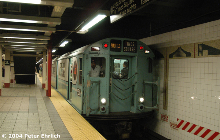 (132k, 720x458)<br><b>Country:</b> United States<br><b>City:</b> New York<br><b>System:</b> New York City Transit<br><b>Line:</b> IRT Times Square-Grand Central Shuttle<br><b>Location:</b> Grand Central <br><b>Route:</b> Fan Trip<br><b>Car:</b> R-33 World's Fair (St. Louis, 1963-64) 9306 <br><b>Photo by:</b> Peter Ehrlich<br><b>Date:</b> 10/27/2004<br><b>Artwork:</b> <i>Arches, Towers, Pyramids</i>, Jackie Ferrara (1997).<br><b>Notes:</b> Train in regular passenger service, technically not a fan trip.<br><b>Viewed (this week/total):</b> 0 / 3121