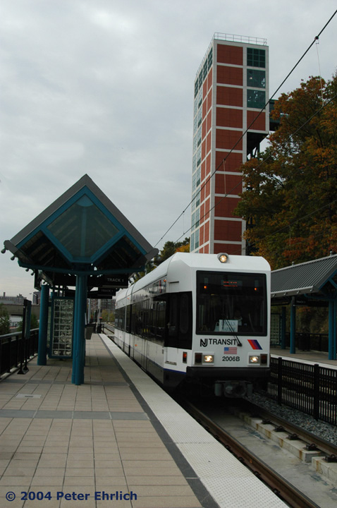 (121k, 478x720)<br><b>Country:</b> United States<br><b>City:</b> Hoboken, NJ<br><b>System:</b> Hudson Bergen Light Rail<br><b>Location:</b> 9th Street <br><b>Car:</b> NJT-HBLR LRV (Kinki-Sharyo, 1998-99)  2006 <br><b>Photo by:</b> Peter Ehrlich<br><b>Date:</b> 10/27/2004<br><b>Notes:</b> Shows the massive elevator structure up to the top of the palisade.<br><b>Viewed (this week/total):</b> 0 / 2453