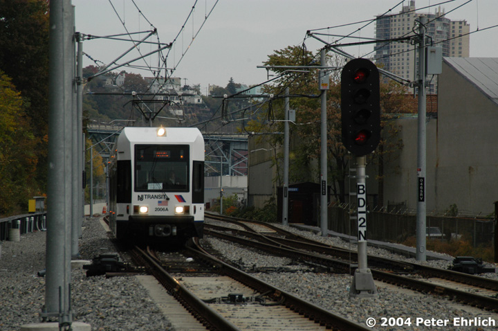 (149k, 720x478)<br><b>Country:</b> United States<br><b>City:</b> Hoboken, NJ<br><b>System:</b> Hudson Bergen Light Rail<br><b>Location:</b> 9th Street <br><b>Car:</b> NJT-HBLR LRV (Kinki-Sharyo, 1998-99)  2006 <br><b>Photo by:</b> Peter Ehrlich<br><b>Date:</b> 10/27/2004<br><b>Viewed (this week/total):</b> 0 / 2709