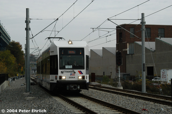 (130k, 720x478)<br><b>Country:</b> United States<br><b>City:</b> Hoboken, NJ<br><b>System:</b> Hudson Bergen Light Rail<br><b>Location:</b> 9th Street <br><b>Car:</b> NJT-HBLR LRV (Kinki-Sharyo, 1998-99)  2006 <br><b>Photo by:</b> Peter Ehrlich<br><b>Date:</b> 10/27/2004<br><b>Viewed (this week/total):</b> 0 / 2112