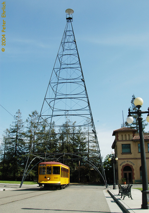 (142k, 504x719)<br><b>Country:</b> United States<br><b>City:</b> San Jose, CA<br><b>System:</b> Kelley Park Vintage Trolley <br><b>Car:</b>  143 <br><b>Photo by:</b> Peter Ehrlich<br><b>Date:</b> 3/28/2004<br><b>Notes:</b> The triangular tower is a smaller replica of the giant tower erected in downtown San Jose from the 1890s until 1915 to light the city.<br><b>Viewed (this week/total):</b> 0 / 1262