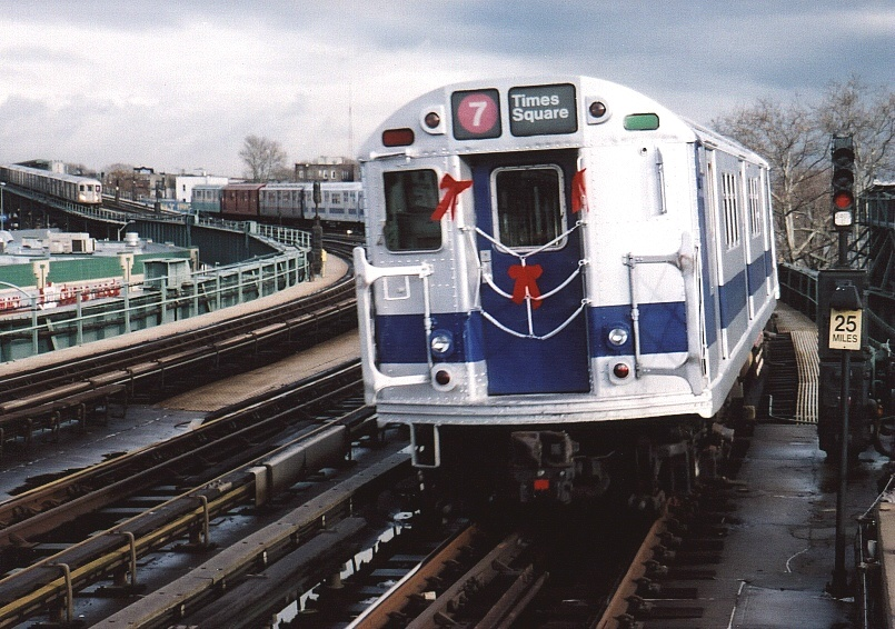 (230k, 805x566)<br><b>Country:</b> United States<br><b>City:</b> New York<br><b>System:</b> New York City Transit<br><b>Line:</b> IRT Flushing Line<br><b>Location:</b> 46th Street/Bliss Street <br><b>Route:</b> Fan Trip<br><b>Car:</b> R-33 Main Line (St. Louis, 1962-63) 9011 <br><b>Photo by:</b> Gary Chatterton<br><b>Date:</b> 11/28/2004<br><b>Notes:</b> R33/SMEE train of many colors in holiday 7 line service.<br><b>Viewed (this week/total):</b> 2 / 3312